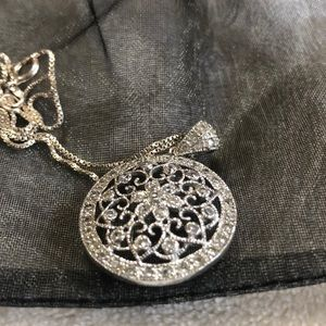 """Sterling silver 16"""" chain and pendant."""